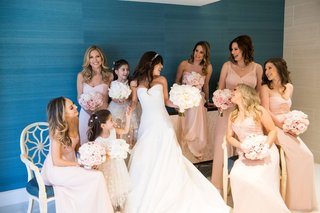 bride-in-oscar-de-la-renta-wedding-dress-pink-bridesmaid-dresses-and-little-maid-of-honor-twins