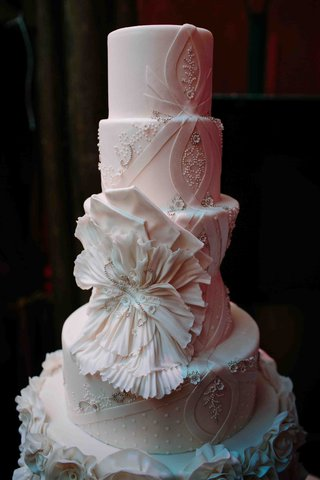 white-wedding-cake-with-each-layer-inspired-by-a-matthew-christopher-wedding-dress-design