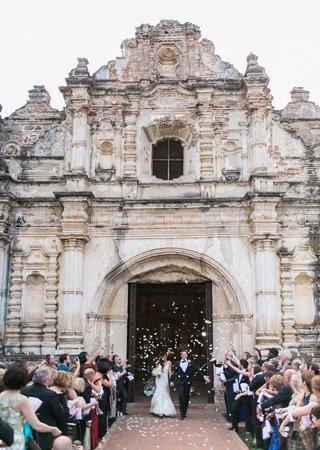 bride-and-groom-leaving-church-doors-guatemala-destination-wedding-flower-petal-toss