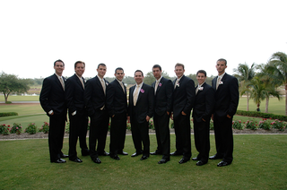groom-and-best-man-with-groomsmen-on-grass-lawn