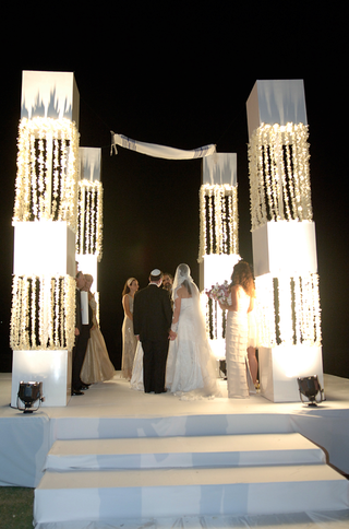 bride-and-groom-under-large-white-chuppah