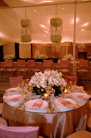 round-table-with-pink-linens-gold-glassware-and-orchid-centerpiece