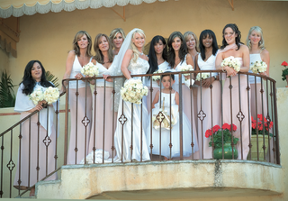 bride-and-bridesmaids-wearing-white-blouses-and-long-pink-skirts