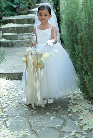 flower-girl-in-a-white-veil-and-tulle-dress-carries-a-golden-basket-with-ribbons
