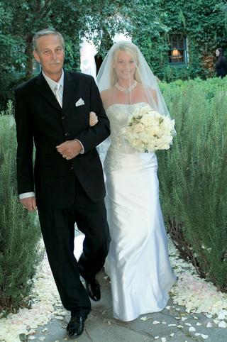 father-of-bride-walks-bride-wearing-a-strapless-gown-with-a-beaded-bodice-down-the-aisle