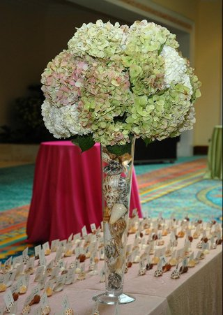 tall-hydrangea-centerpiece-filled-with-seashells
