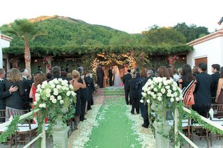 green-aisle-runner-leads-to-chuppah-on-terrace