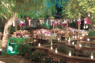 evening-reception-with-pink-flowers-and-candlelight