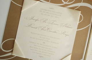 wedding-stationery-with-satin-ivory-corners-on-gold-paper