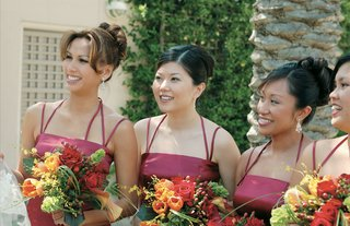 bridesmaids-with-fall-colored-bouquets-in-red-dresses