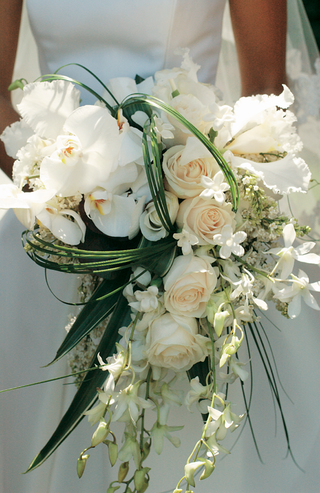 wedding-bouquet-with-roses-orchids-and-palm-fronds
