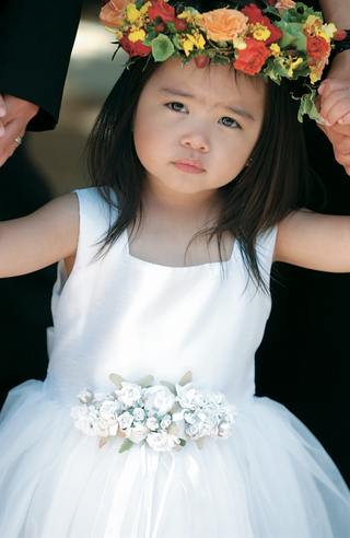 flower-girl-in-white-dress-with-colorful-flower-crown