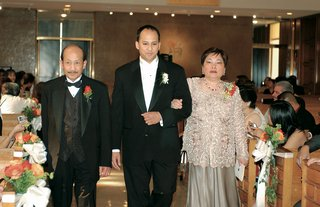 groom-with-father-and-mother-walk-down-aisle