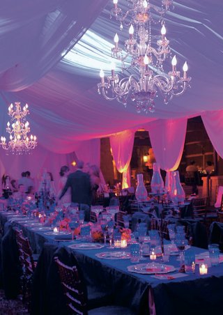 wedding-reception-with-draping-and-crystal-chandeliers
