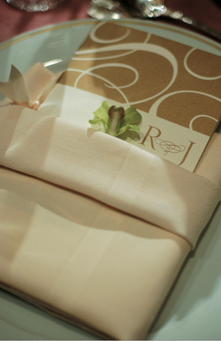 gold-reception-menu-inside-beige-linen-napkin
