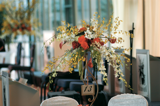 iron-stand-holding-table-number-and-flowers