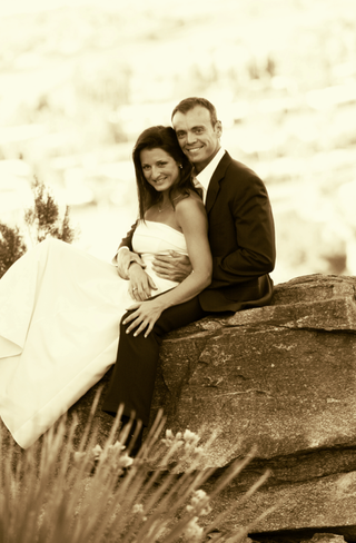 sepia-toned-photo-of-bride-and-groom-on-rock