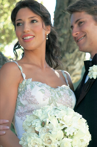 bride-with-unique-flower-wedding-dress-and-groom-in-tux