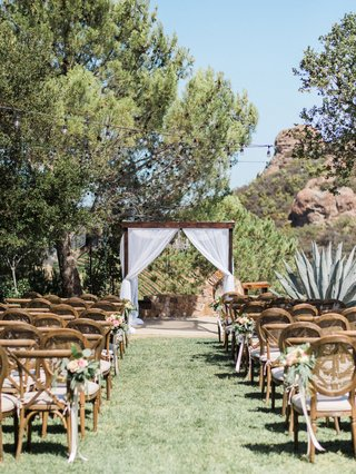 megan-nicole-youtube-singer-outdoor-wedding-wood-vineyard-chairs-wood-arbor-drapery-backyard-wedding