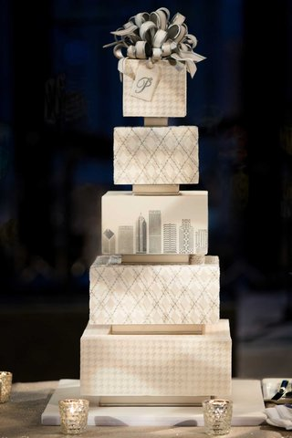 wedding-cake-with-houndstooth-and-argyle-pattern-layers-chicago-skyline-bow-cake-topper