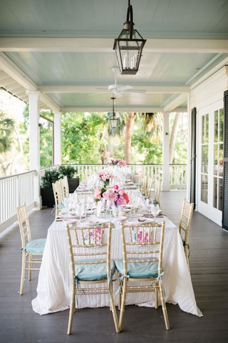 wedding-reception-wraparound-porch-southern-destination-wedding-pastel-color-palette-gold-chairs