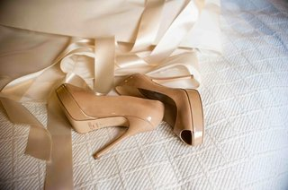 jimmy-choo-nude-peep-toe-pump-on-white-comforter