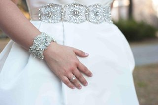 bride-with-white-wedding-dress-crystal-bracelet-and-belt
