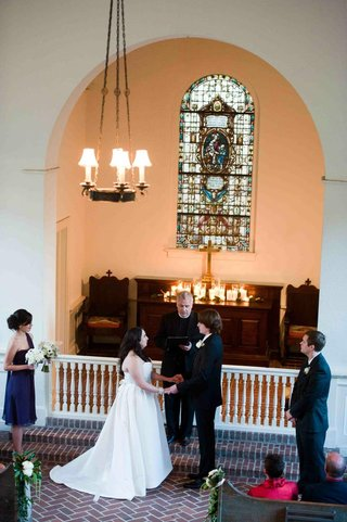 bride-and-groom-on-bricks-in-front-of-chapel-altar