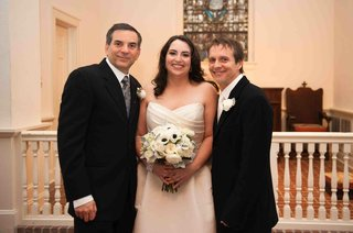 bride-with-two-men-in-black-suits-with-white-boutonnieres