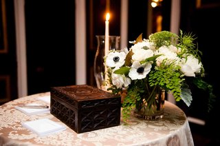wooden-box-on-damask-linen-with-anemone-flower-arrangement
