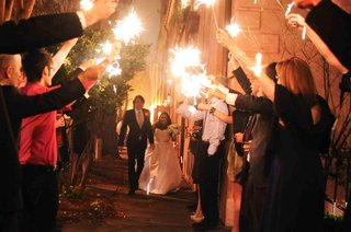 bride-and-groom-walk-through-tunnel-of-sparklers