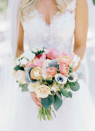 bride-in-mark-ingram-atelier-wedding-dress-with-bouquet-peach-pink-orange-blue-green-flower-anemone