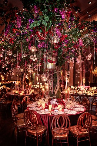 wedding-reception-round-table-large-tree-crystal-glass-orb-tea-light-purple-red-flowers-greenery