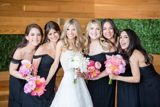 bride-in-strapless-reem-acra-wedding-dress-with-bridesmaids-black-gowns-dresses-pink-coral-peony