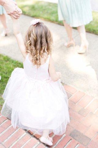 flower-girl-in-a-sleeveless-pastel-pink-dress-and-ballet-slippers