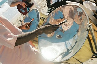 musicians-perform-steel-drum-and-guitar-music-on-beach
