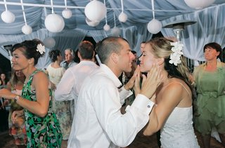 bride-and-groom-dance-with-guests-at-beach-tent-wedding