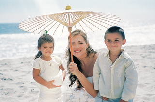 bride-with-casual-flower-girl-and-ring-bearer-for-beach-wedding