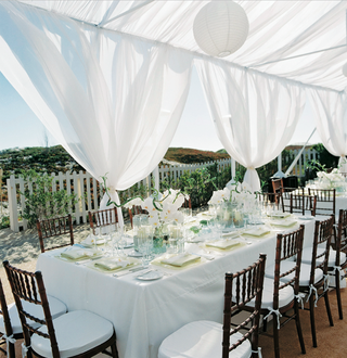 outdoor-reception-with-white-tent-on-sand