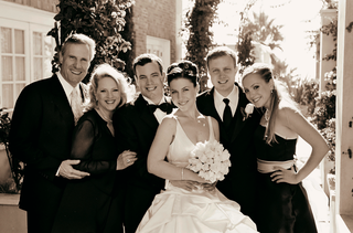 newlyweds-pose-with-family-members