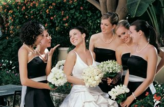 black-dresses-with-white-ribbon-belt-and-bride-carrying-bouquet