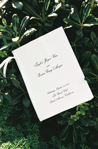 wedding-program-with-calligraphy-and-ribbon
