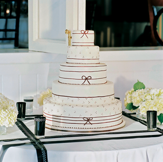 five-tiered-white-cake-with-thin-black-ribbons-and-dots