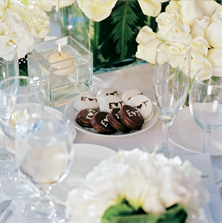 monogrammed-chocolate-oreos-on-table-surrounded-by-flowers