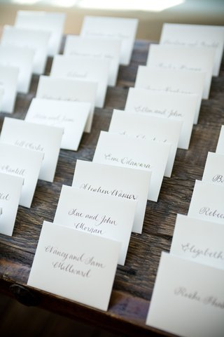white-place-cards-with-brown-handwritten-names
