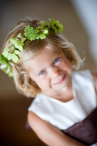 flower-girl-wearing-green-orchid-flower-crown