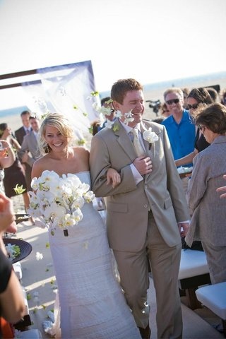 bride-and-groom-walk-up-aisle-at-beach-wedding-ceremony