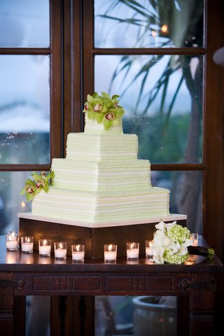 four-layer-cake-with-white-and-lime-green-frosting