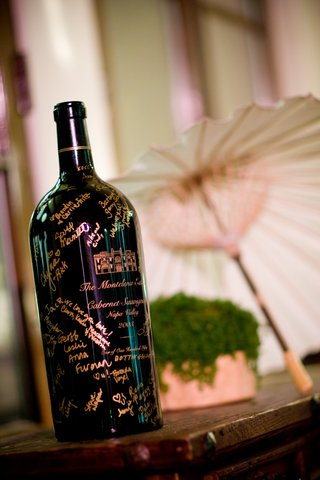 black-wine-bottle-guest-book-with-gold-signatures