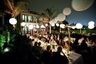 guests-eat-at-outdoor-reception-table-at-night